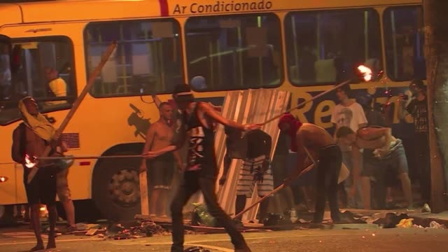 brazilian police fired teargas and stung grenades friday to disperse street riots after protests against public transport fare hikes turned violent - fare video stock e b–roll