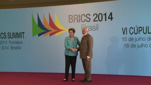 vídeos de stock, filmes e b-roll de brazilian president dilma rousseff received tuesday in fortaleza the leaders of the brics group of emerging powers to the summit in which they plan... - newly industrialized country
