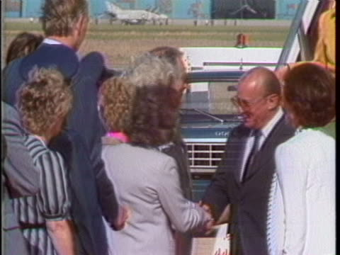 vídeos y material grabado en eventos de stock de brazilian president joao baptista figueiredo walks out of airplane and is greeted on the tarmac as he arrives for his official visit of the united... - baptista