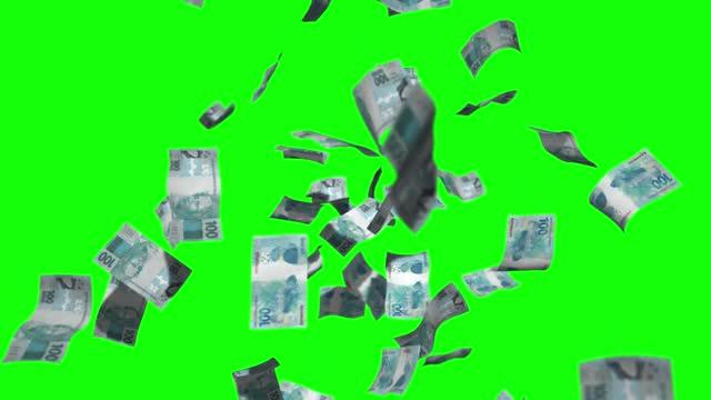vídeos de stock, filmes e b-roll de 100 reais / nota real, rainig dinheiro tela verde chroma fundo 4k stock video - nota