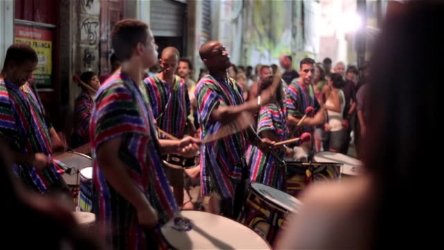 Brazilian samba band dance and drum in rhythm at outdoor concert