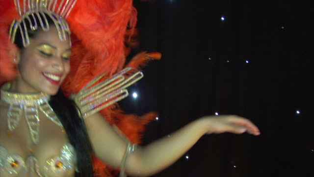 CU, SLO MO, Brazilian samba dancer performing on stage, London, England