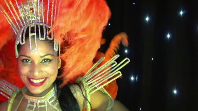 CU, SLO MO, TD,  Brazilian samba dancer performing on stage, London, England