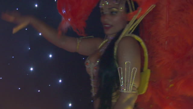 cu, swish pan, brazilian samba dancers performing on stage, london, england, - swish pan stock videos & royalty-free footage