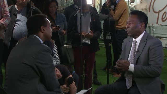 brazilian star pele to auction off memorabilia england london int pele interview sot close shot of embroidered badge - ラゲ オマール点の映像素材/bロール