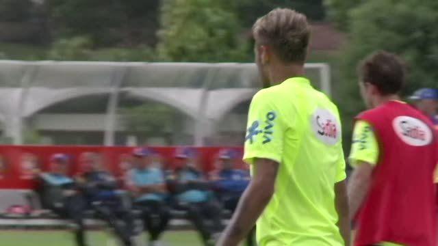 brazilian superstar striker neymar changes his hairstyle again and dyes it golden blond inspiring teammate dani alves to add a silvery touch to his... - neymar da silva stock-videos und b-roll-filmmaterial