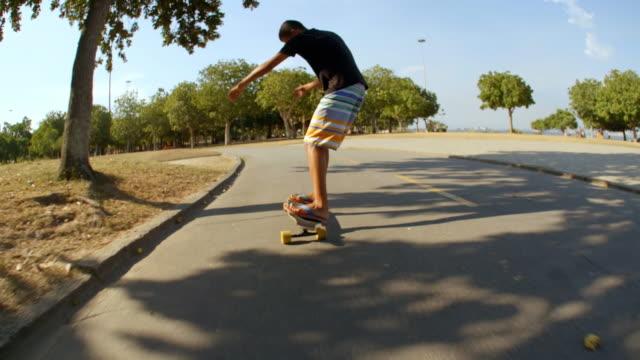 Brazilian teen skates Rio street on longboard in slow motion