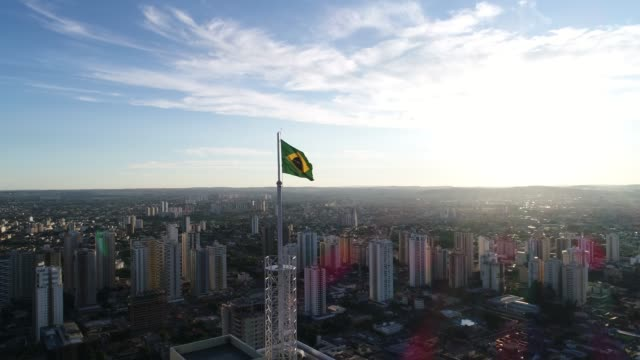 brazilian waving flag at skyline of goiânia, goiás - flag stock videos & royalty-free footage