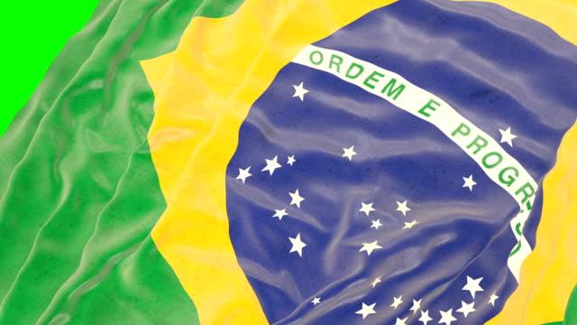 brazilian waving flag. green screen. close up - brazilian culture stock videos & royalty-free footage