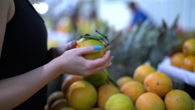 brazilian woman buying fruits on street market - citrus fruit stock videos & royalty-free footage