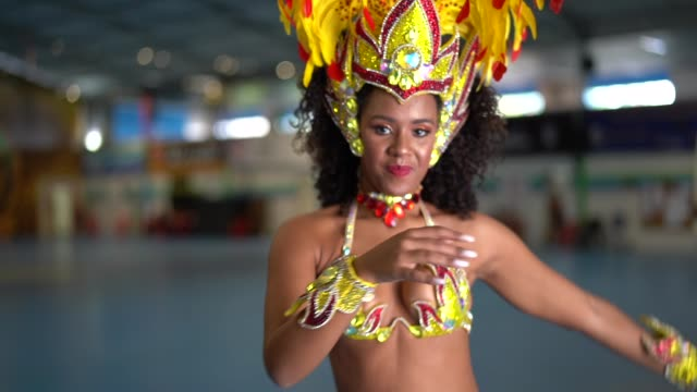 brazilian woman dancing samba for the famous carnival parade - mardi gras stock videos and b-roll footage