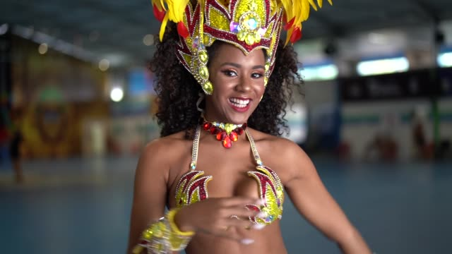 brazilian woman dancing samba for the famous carnival parade - showgirl stock videos and b-roll footage