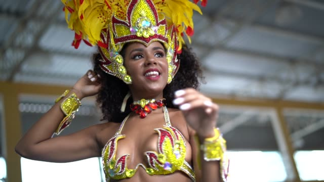 brazilian woman dancing samba for the famous carnival parade - fancy dress costume stock videos and b-roll footage