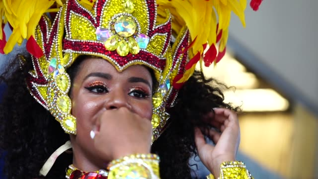 brazilian woman dancing samba for the famous carnival parade - latin america stock videos & royalty-free footage