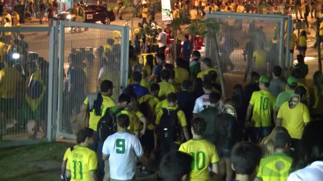 vídeos y material grabado en eventos de stock de brazilians cried cursed their president and covered their faces in shame after their beloved football teams humiliating 71 thrashing by germany in... - ronda de semifinales