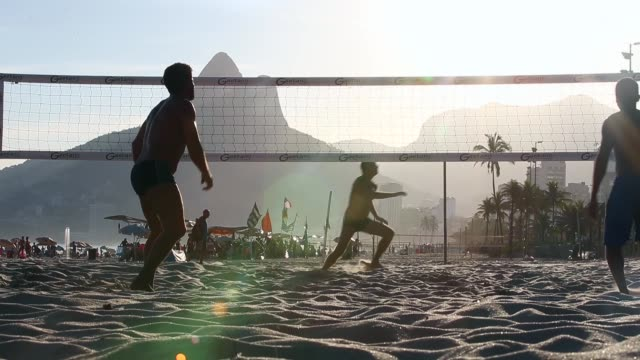 Brazilians play footvolley a spinoff of soccer played on the beach on Ipanema Beach on March 19 2014 in Rio de Janeiro Brazil Footvolley involves...
