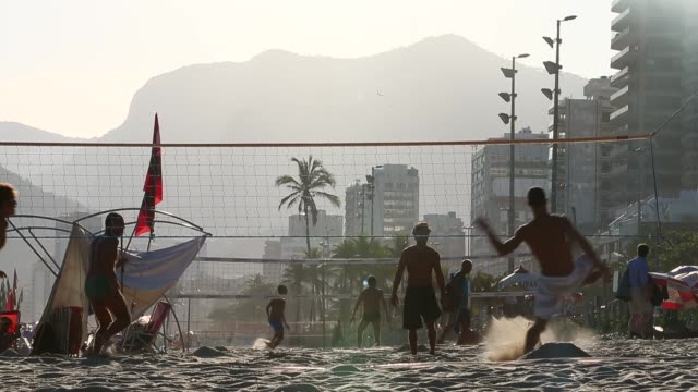 brazilians play footvolley a spinoff of soccer played on the beach on ipanema beach on march 19 2014 in rio de janeiro brazil footvolley involves... - volleyball net stock videos & royalty-free footage