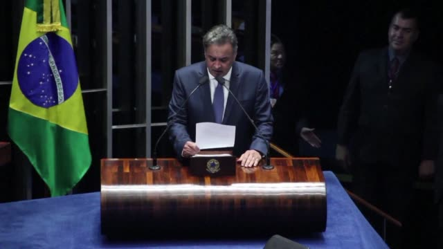 Brazil's government allied Senator Aecio Neves charged with corruption returns to Congress after the country's highest court annulled his suspension