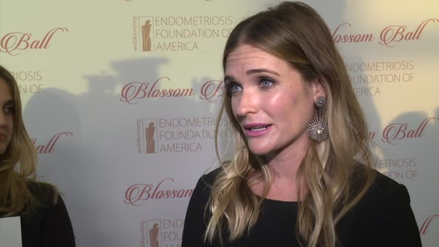 stockvideo's en b-roll-footage met interview bre blair talks about wanting to learn more about the disease at 8th annual blossom ball to benefit the endometriosis foundation of america... - chelsea piers
