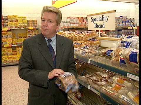 Bread on supermarket shelves i/c Soya flour in pan Linseed in pan Bread on supermarket shelves PAN London GIR Dr Ed Filmore intvwd soya and linseed...