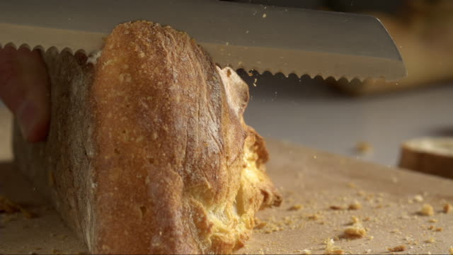 bread cut by knife in highspeed - kräuter stock-videos und b-roll-filmmaterial