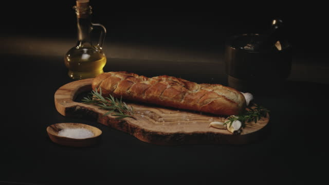 bread on cutting board - french food stock videos & royalty-free footage