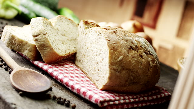 bread on wooden table - loaf stock videos & royalty-free footage