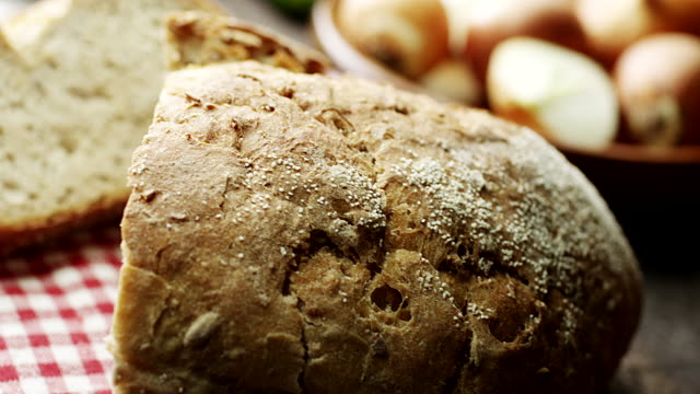 bread on wooden table - bread stock videos & royalty-free footage