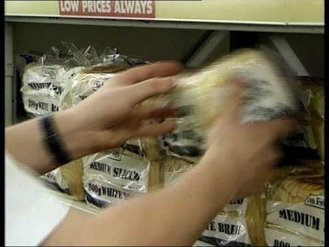 Bread price wars ITN GV shop assistant putting crates of bread onto shelf in branch of Kwik Save GV bread with Kiwk Save brand label quotNo...