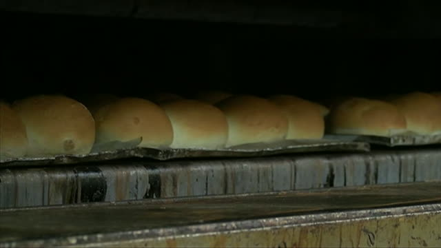 bread rolls baked in bakery, lincoln - baking stock videos & royalty-free footage
