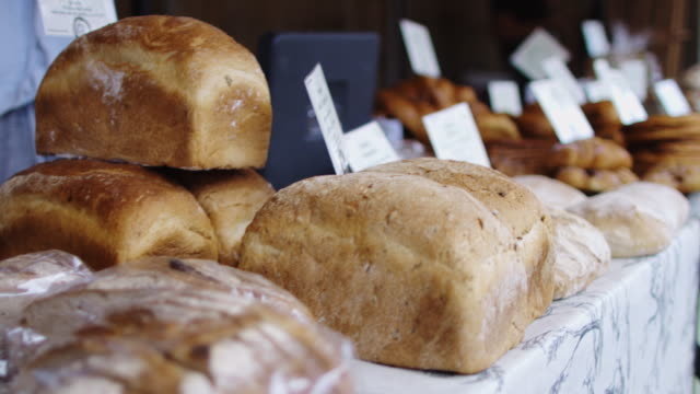 bread stall on farmers market - bakery stock videos and b-roll footage