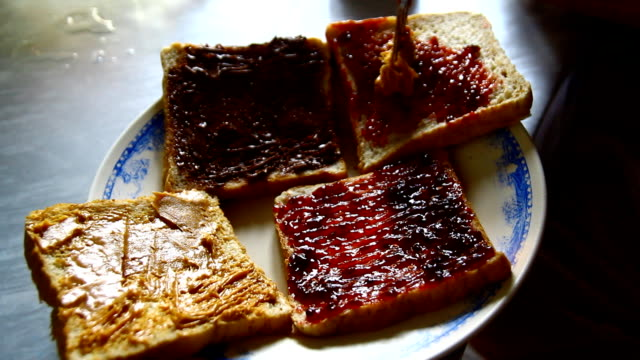 bread with jam ,hand - preserve stock videos and b-roll footage
