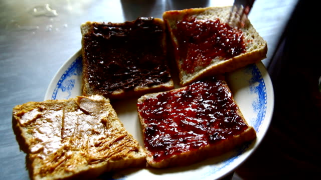 bread with jam ,hand - jam stock videos & royalty-free footage