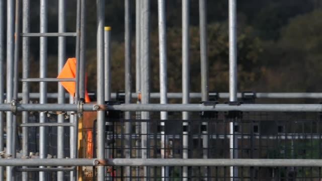 vídeos de stock, filmes e b-roll de severe housing shortage in jaywick england clacton jaywick adrian docherty interview as sitting in caravan sot close shot skeleton figure hanging... - soft focus