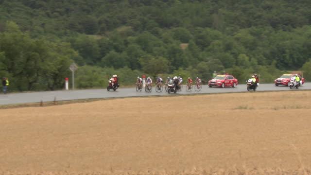 ts breakaway from tour de france peloton. on d994 to gap - ツール・ド・フランス点の映像素材/bロール
