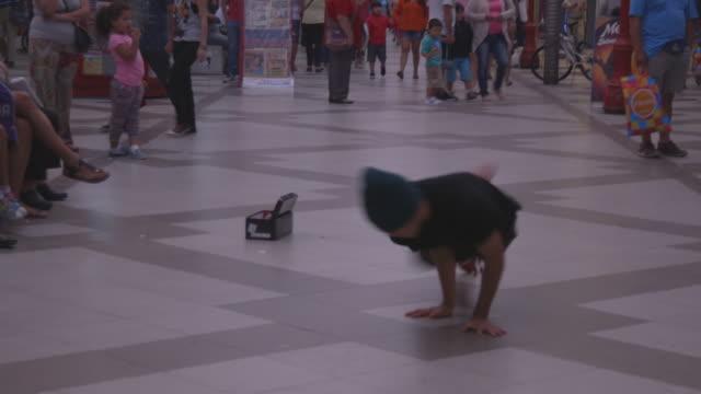 breakdancer performs on street, wide shot - street performer stock videos & royalty-free footage