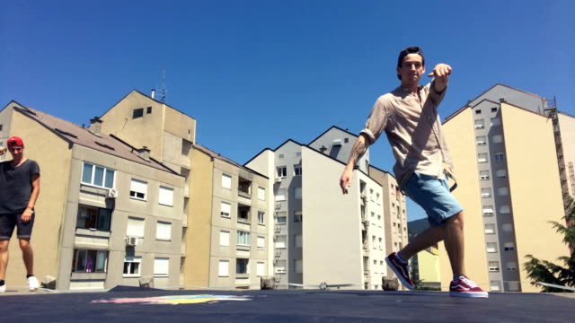 breakdancers dancing on a roof in a city - street performer stock videos and b-roll footage