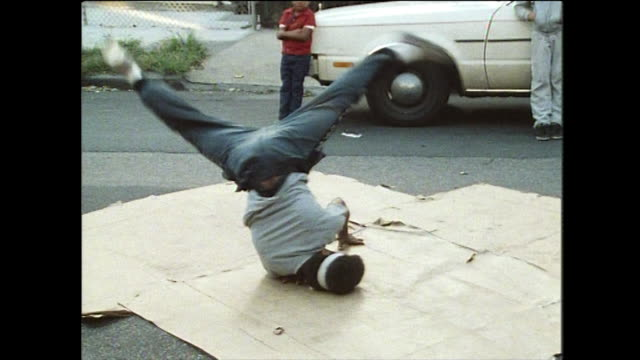 breakdancing block party in a new york front yard; 1984 - di archivio video stock e b–roll