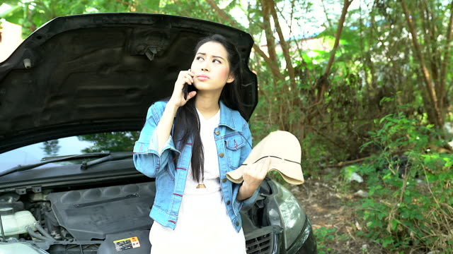 breakdown of the car on the road. the girl is waiting for the tow truck. the girl is upset by the car breakdown. - tow truck stock videos and b-roll footage