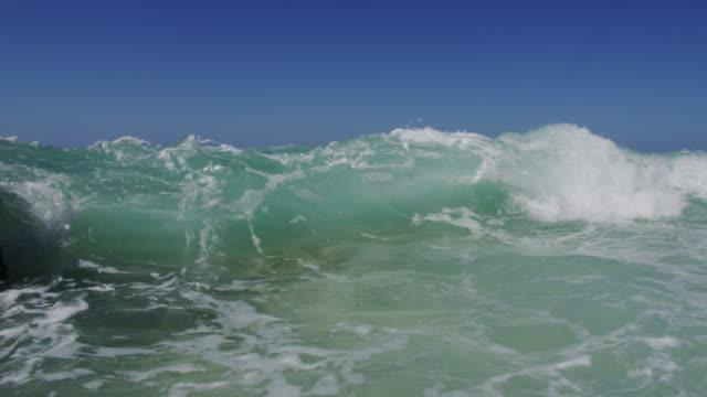 breaker crashes over camera on beach, bahamas - bimini stock videos & royalty-free footage
