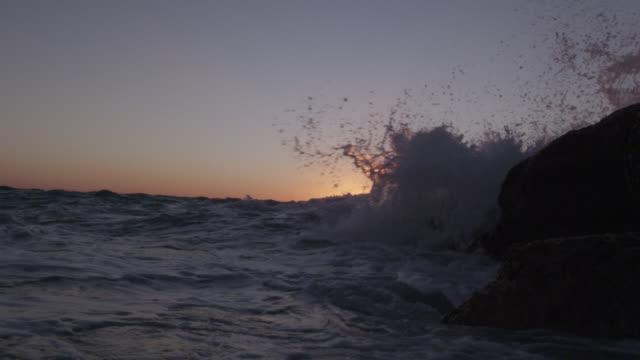 stockvideo's en b-roll-footage met breaker splashes over camera at sunset, bahamas - bimini