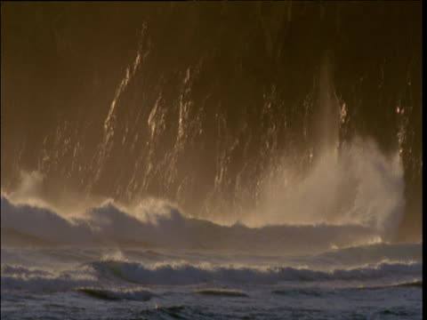 breakers crash and foam on rocky cliff, lord howe island, australia - ムラがある点の映像素材/bロール