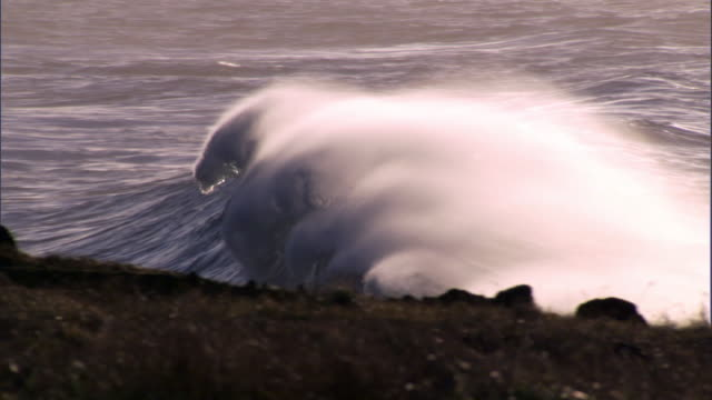 breakers roll onto rocky coast at sunrise, easter island - island stock videos and b-roll footage