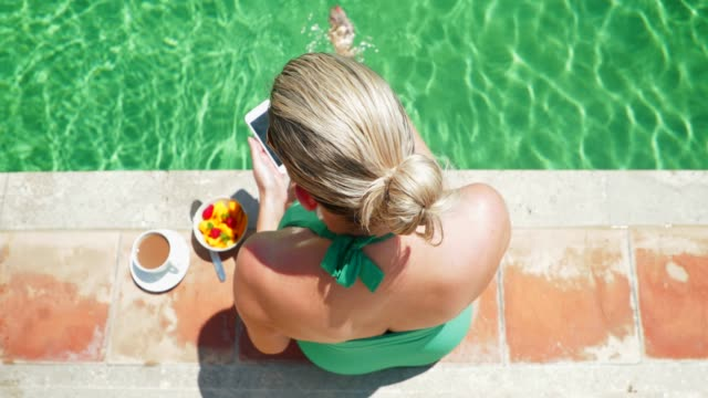 breakfast by the pool - ponytail stock videos & royalty-free footage