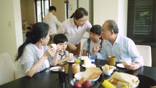 breakfast gathering - multi generation family stock videos & royalty-free footage