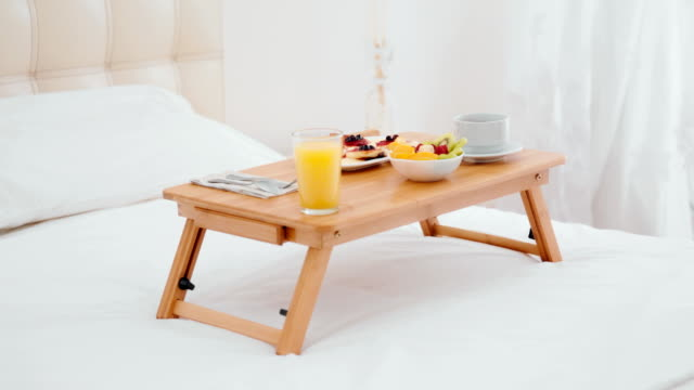 Breakfast in bed served on small table