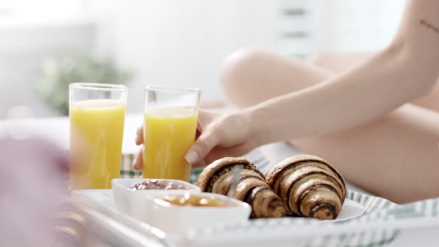breakfast in bed - croissant stock videos & royalty-free footage