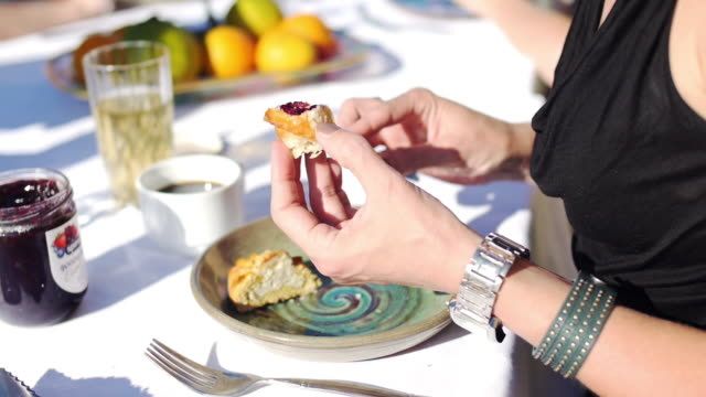 breakfast in sun with croissant and jam - baked pastry item stock videos and b-roll footage