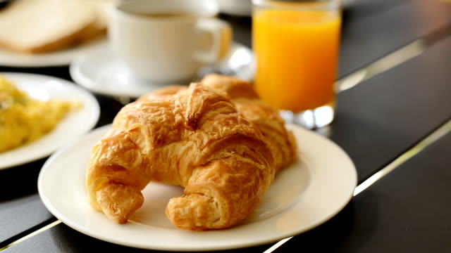 breakfast set served high-definition video pan - croissant stock videos & royalty-free footage