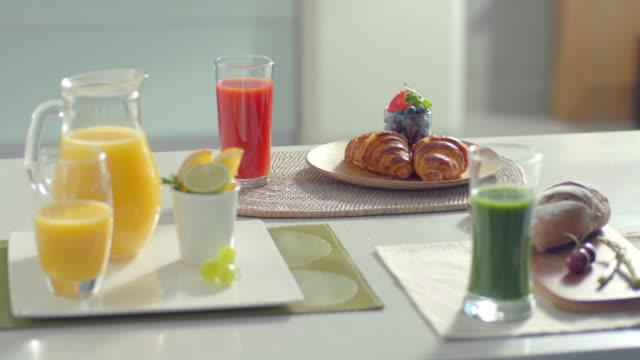 Breakfast table- Fresh juice of various colors with Bread and Fruit